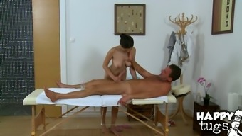Bosomy Asian hottie sucks white colored large cock in massage therapy parlor