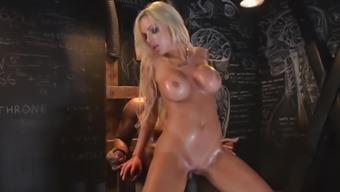 Busty blonde Nina Elle bends over to produce a black hard on