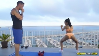 apolonia lapiedra and her professional personal trainer are performing from the roof-top