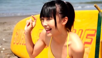 Lovable Far eastern archangel Mizuki Moe walks trough the beach