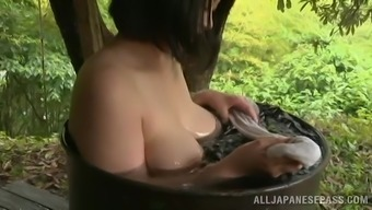 Lovely Japanese Baby Takes A Great Take a bath Outdoor Within a Elegant Tale