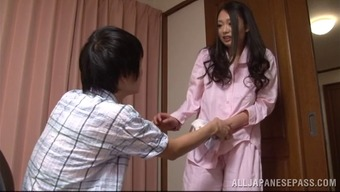 A sweet Japanese people housewife gives her one a handjob