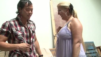 Chubby MILF gets fucked with some From asia dude inside a utility space