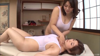 Big titty Japanese masseuse seduces a female and screws her