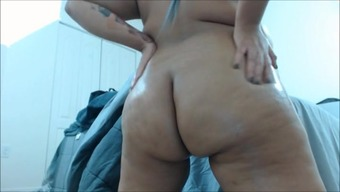 Plus-size woman With the use of Substantial Getting Oiled Right up