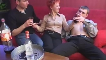 Over the course of occasion a redheaded MILF represents four males at one time
