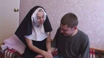 Nun fucks by using a pair of little guys