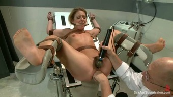 Incarcerated blond gets bound and fucked by a doctor