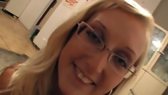 Welcoming cougar in glasses giving out a nasty handjob in POV