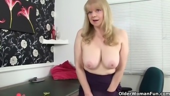 British gilf along with large tits pantyhose rubs her pierced pussy