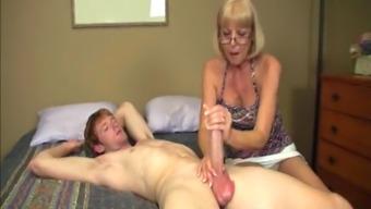 Senior babe gives malicious handjob