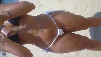 Wireless and Voyeur Sizzling nasty person pussy at the coast