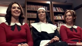 Sexy nun manipulates a pair of attractive babes in school even