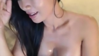 Attractive blond milf asian petting on camera