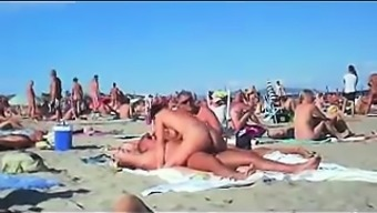 cuckolding within a topless seashore gets recorded