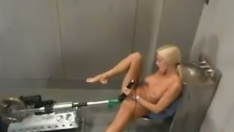 Cassie moans loudly while being fucked through a sex machinery