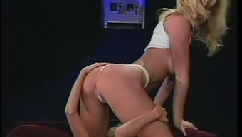 Lesbian Julia Ann undressing and keeping intercourse back with her darling