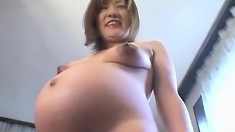 Far eastern preggo acts with the tits