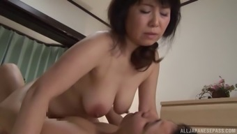 Curvaceous Japanese milf fed themselves out and infiltrate erotically