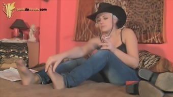 Using cowgirl shows some pantyhose underneath her blue jeans