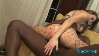 Slut in ripped fishnet pantyhose gives a blowjob and gets her pussy blacked
