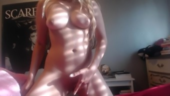Adorable blonde strip and remove and play her pussy