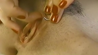 Cute and sexy amateur brunette tickles her own pierced clit