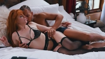 Redhead slut in erotic underwear missionary fucked by a black guy