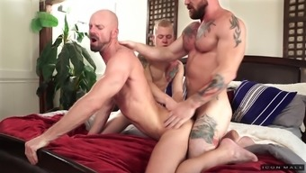Sporty gay threesome with buffed dudes at a hotel room