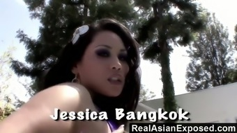 Curvy Asian chick Jessica Bangkok dildo fucks her twat and gets nailed by the poolside