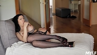 Chesty Cassandra Cain dons fishnets and rubs her juicy pussy