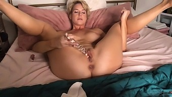 Busty solo wife Kit Mercer enjoys pleasuring her cunt with a dildo