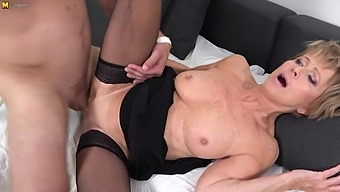 Sexy grandma seduces young man and sucks his cock before he fucks her shaved pussy