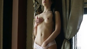 Splendidly gorgeous Ukraine young adult fondling her pussy on video camera