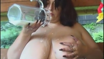 Big breasts infant squizing her melons and twiddling with dairy products