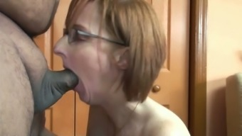 Red-haired milf in spectacles sucks a small shaft within