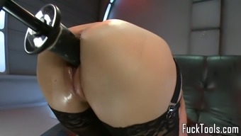 Some kind of toy dame crushed by using dildo system squirts