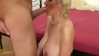 Horn-mad wrinkly curly blonde senior Big beautiful woman in dark colored stuff opens up titties