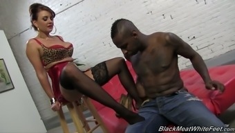Busty blonde MILF in sexy dry night-time dress Janet Mason rubs BBC with feet