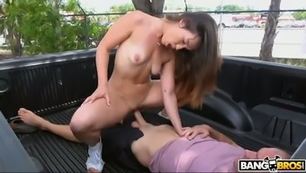 Long haired leggy nympho Kelsi Monroe gives a good BJ right in the car